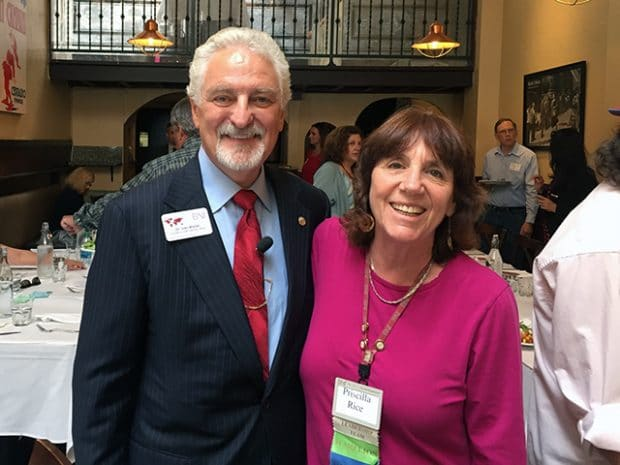 "Ivan Misner poses for a photo with Priscilla Rice when visiting the ""Thank Goodness It's Wednesday"" BNI chapter in Burlingame"